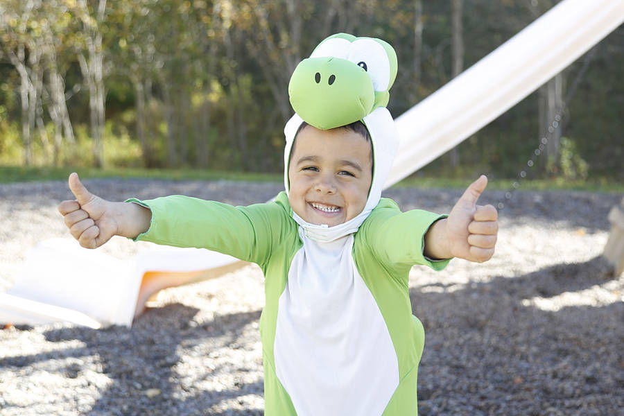 <p>Jace Hiltz, also known as Yoshi, gives a big thumbs up.</p>