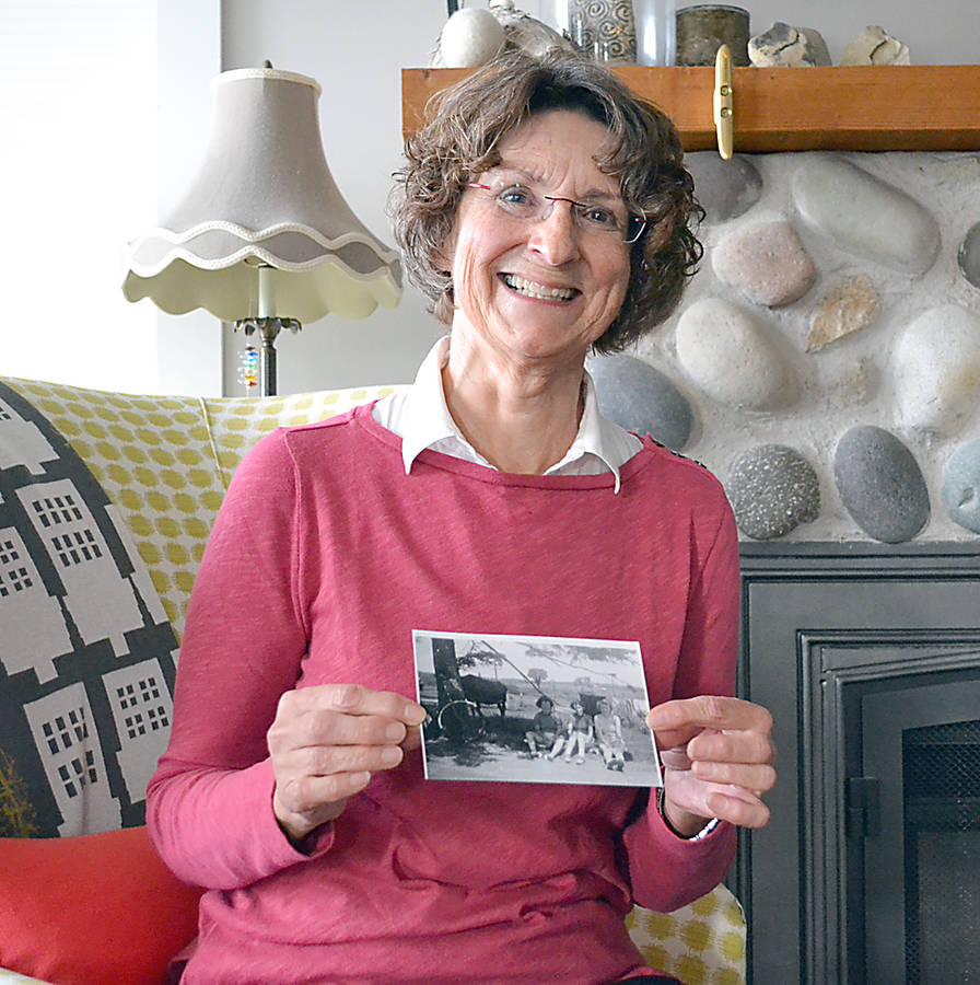 <p>GAYLE WILSON PHOTO</p><p>Ann Barry, the author of <em> Sweet Ride</em>, holds up one of the photographs of the bicycle journey her mother, aunt and two other women took from Blockhouse to Charlottetown in 1943.</p>