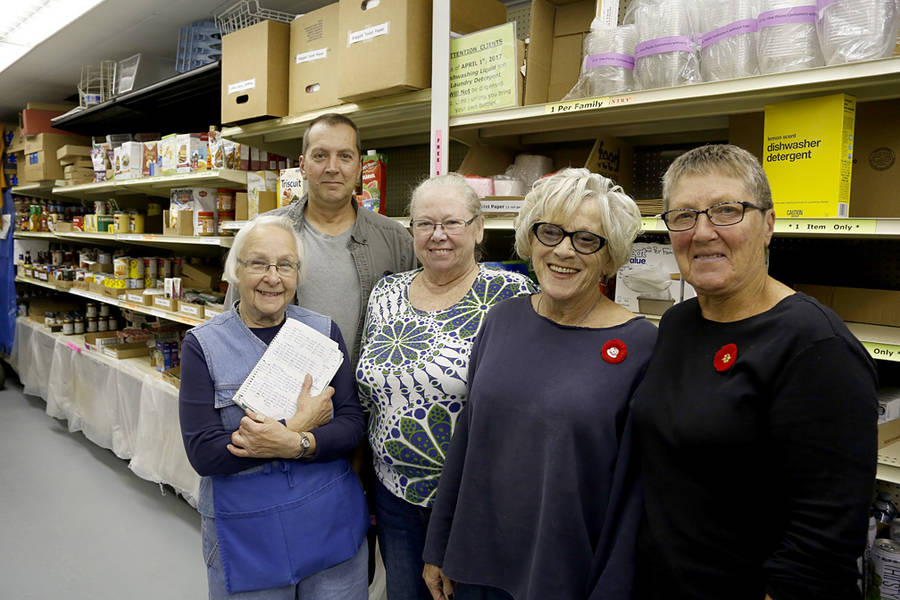 <p>BRITTANY WENTZELL PHOTO</p><p>Charlotte White, Debbie Harding, Kevin Oickle, Helen Harrington, and Pat Fralic, all volunteers with the Queens County Food Bank. The food bank recently increased their capacity to meet the needs of their clients.</p>