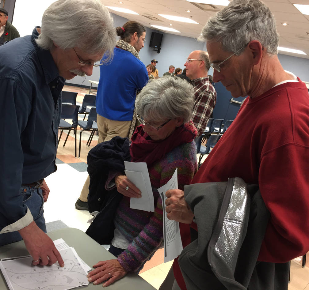 <p>KEITH CORCORAN PHOTO</p><p>Lunenburg's town engineer Marc Belliveau, left, answers questions during the November 9 information session.</p>