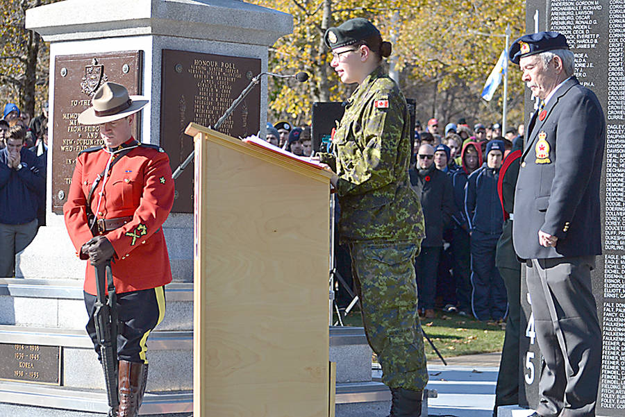 <p>GAYLE WILSON PHOTO</p><p>Private Tess Vachon of the West Nova Scotia Regiment reads the poem she wrote, <em>I Met A Veteran Today</em> at the Remembrance Day ceremony in Bridgewater.</p>