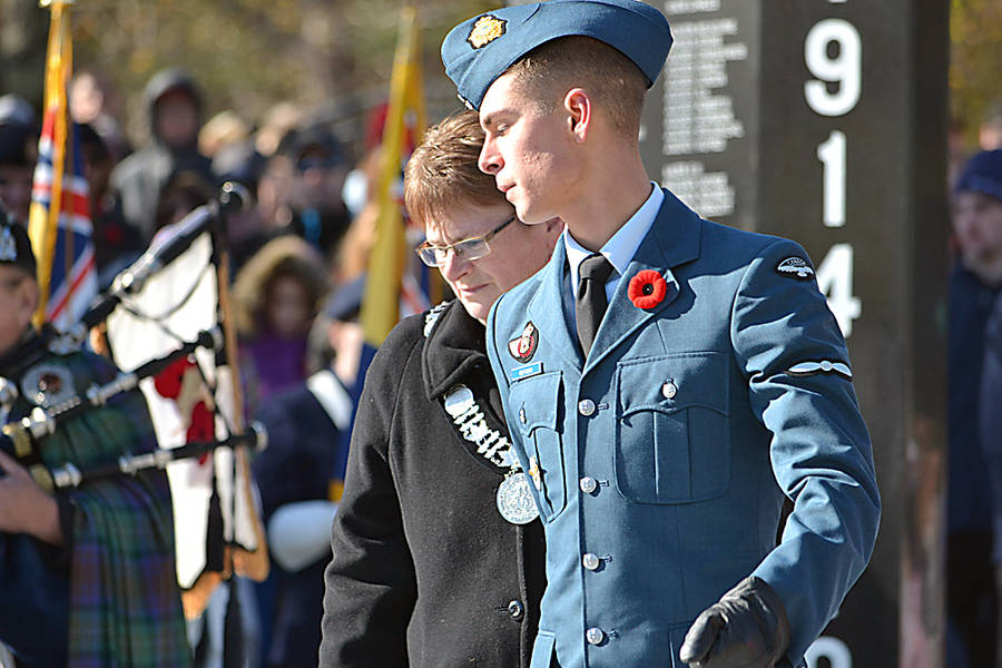 <p>GAYLE WILSON PHOTO</p><p>Carolyn Bolivar-Getson, the mayor of the Municipality of the District of Lunenburg, is escorted by her son Aviator Conrad Getson to lay a wreath at the cenotaph during the Remembrance Day ceremony in Bridgewater.</p>