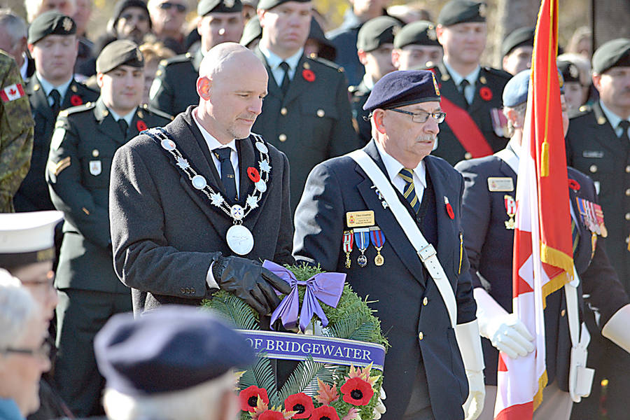 <p>GAYLE WILSON PHOTO</p><p>Bridgewater Mayor David Mitchell approaches the cenotaph during the Remembrance Day ceremony to lay a wreath on behalf of the town.</p>