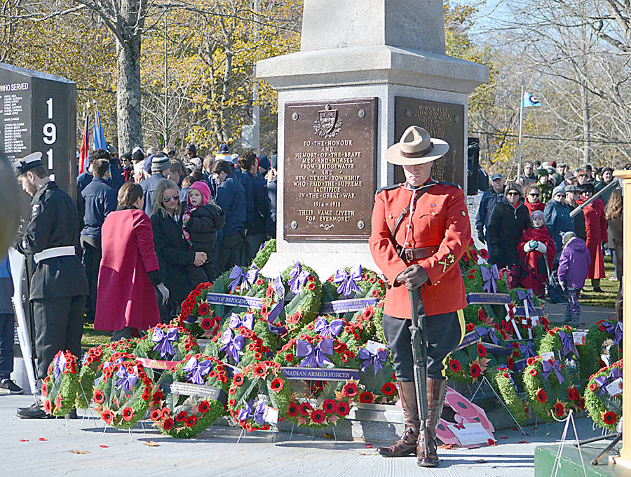 <p>GAYLE WILSON PHOTO</p><p>Sharp winds and chilly temperature failed to dissuade throngs of people from attending this year's Remembrance Day ceremony in Bridgewater and laying a pile of wreaths at the base of the ceonotaph.</p>