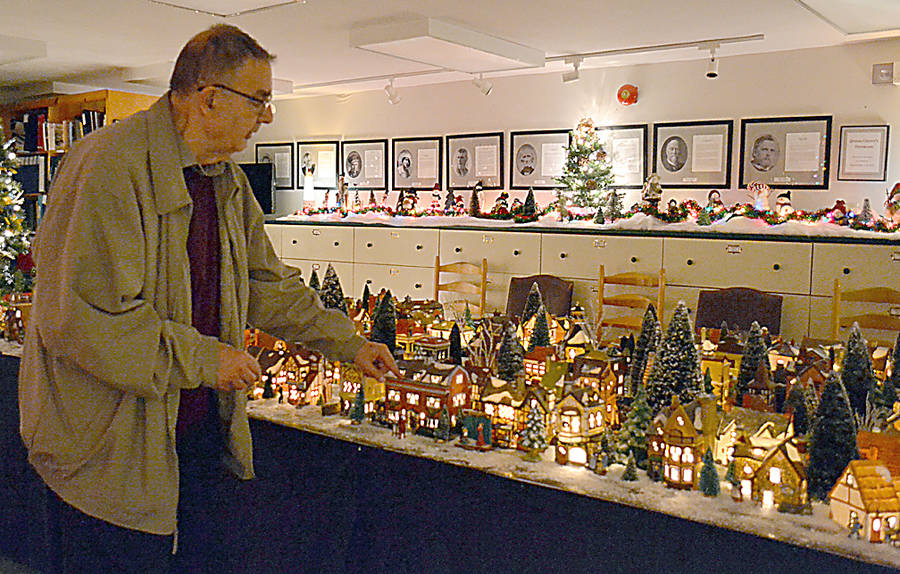 <p>GAYLE WILSON PHOTO</p><p>George Mitchell of Liverpool, here with the Dickens Christmas village he now loans to the museum at Christmas time. Mitchell has been collecting the Dickens buildings for the past 20 years, and up until two years erected the display at his home every year.</p>