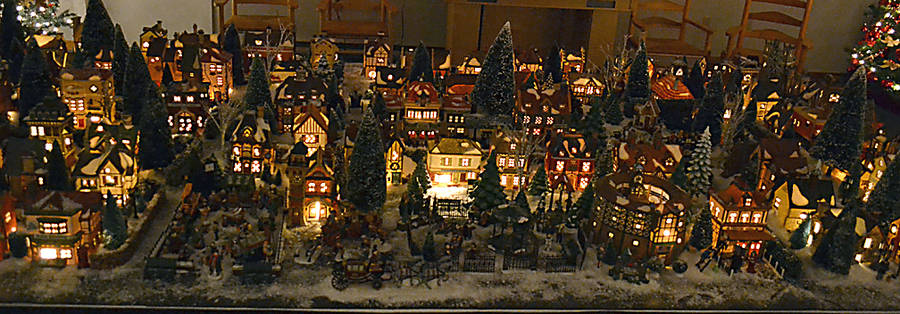 <p>GAYLE WILSON PHOTO</p><p>Each structure in the Dickens Christmas village collection reflects a building in one of his novels.</p>