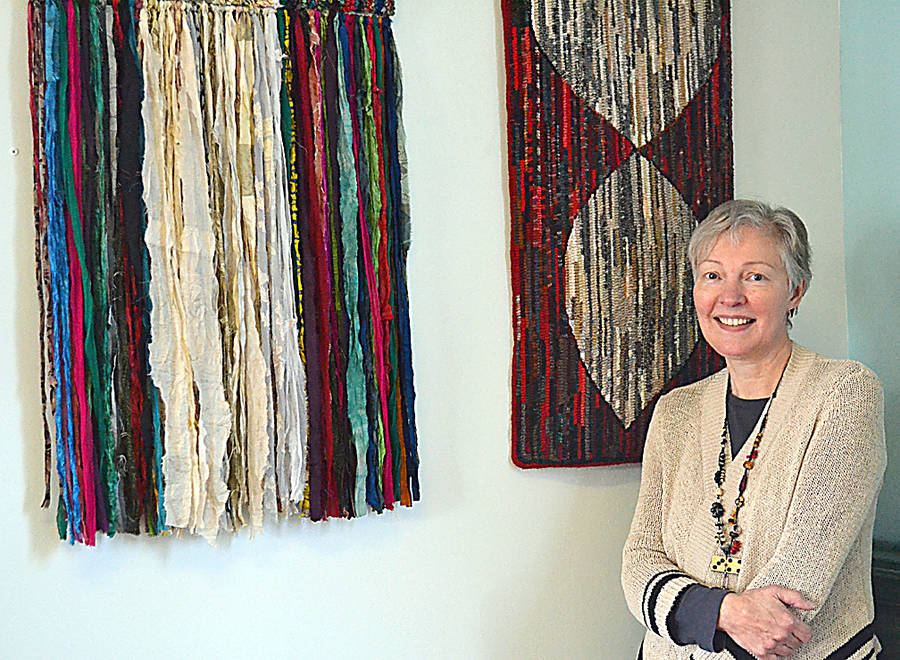 <p>GAYLE WILSON PHOTO</p><p>Jane Steele, owner of River House Rug Hooking, uses a number of textiles to create her designs including silk.</p>