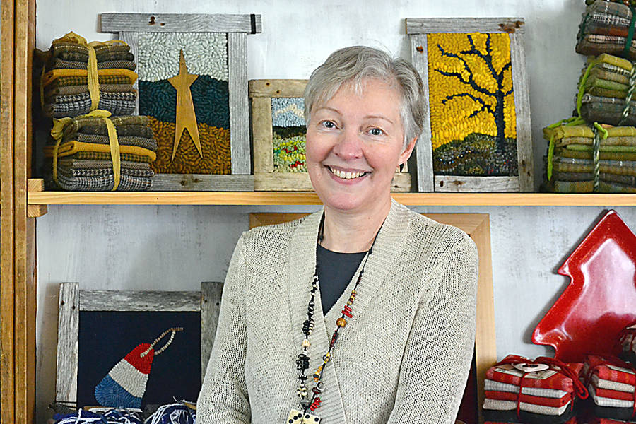 <p>Jane Steele, owner of River House Rug Hooking in Petite Rivière, where crafters can find a wide selection of rug hooking supplies and finished work.</p>