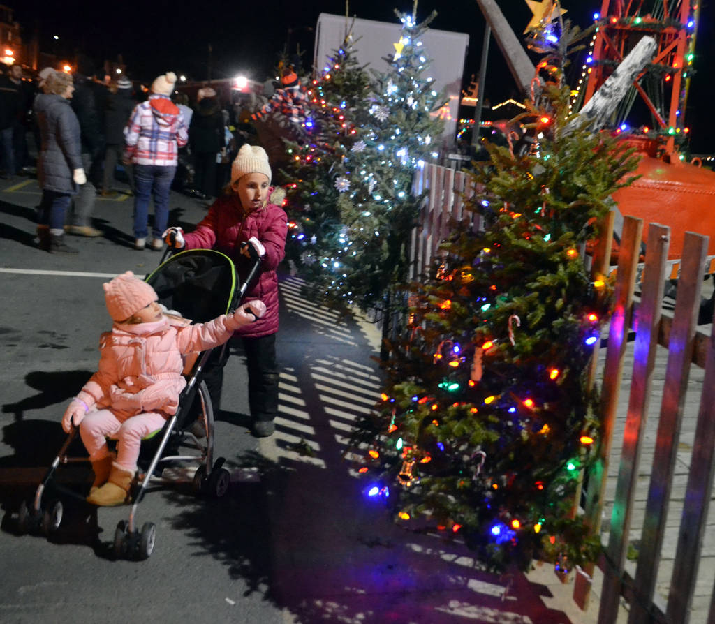 <p>Eden Risser pushes Anna Bower around in the stroller as the pair check out some of the light displays on the waterfront.</p>