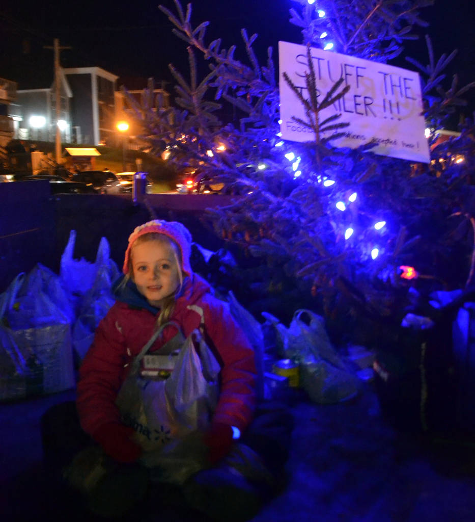 <p>Fifi Risser keeps watch of food bank donations.</p>