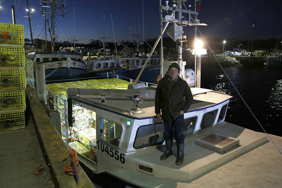<p>BRITTANY WENTZELL PHOTO</p><p>Robin Fisher stands on his boat just before his crew comes aboard. Fisher, along with his brother Brian, have been fishing for decades, beginning with cod before the collapse off the coast of Newfoundland, and later with lobster off Port Mouton.</p>