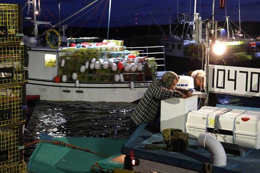 <p>BRITTANY WENTZELL PHOTO</p><p>Fishermen make last minute adjustments before the season official opens.</p>