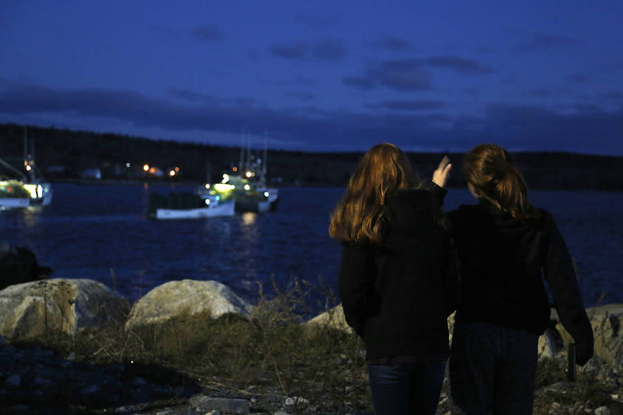 <p>BRITTANY WENTZELL PHOTOS</p><p>Two teens wave to family members as they leave the harbour.</p>