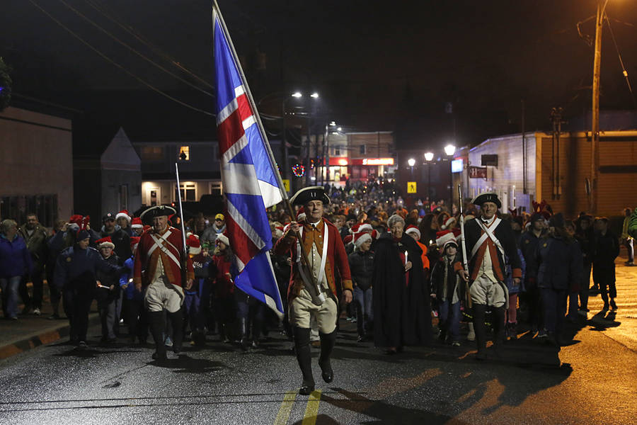 <p>BRITTANY WENTZELL PHOTO</p><p>Owen Hamlin leads hundreds of community members in a parade of light across the bridge. Every year since the beginning of the festival, community members are encouraged to walk with candles from the Town Hall Arts and Cultural Centre to Lane's Privateer Inn.</p>