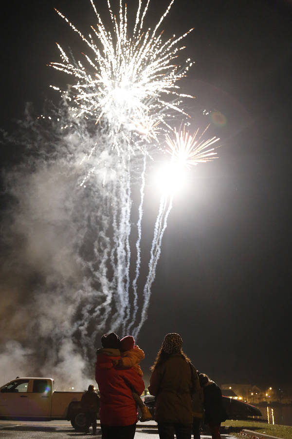 <p>BRITTANY WENTZELL PHOTO</p><p>A family watches the fireworks from the parking lot.</p>