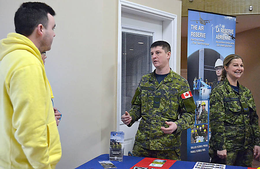 <p>GAYLE WILSON PHOTO</p><p>Mitchell Outbridge (left) was one of the attendees of 143 CEF's open house on February 24. The 17-year-old said he was checking it out to possibly sign up for the summer.</p>