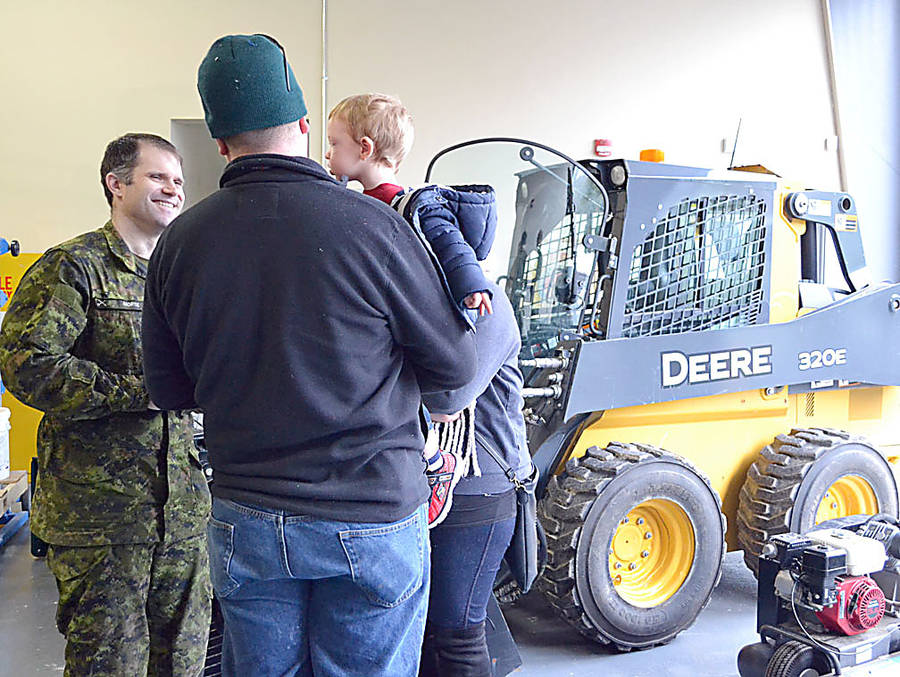 <p>Sergeant Matt Morse of 143 CEF talks with Master Corporal Adam Dogget who came in while off duty with his wife Alyssa and their 16-month-old son William. A future reservist?</p>