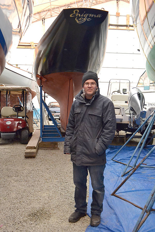 <p>GAYLE WILSON PHOTOS</p><p>Bruce Thompson next to the International One Design boat his company, Tern Boatworks, built.</p>