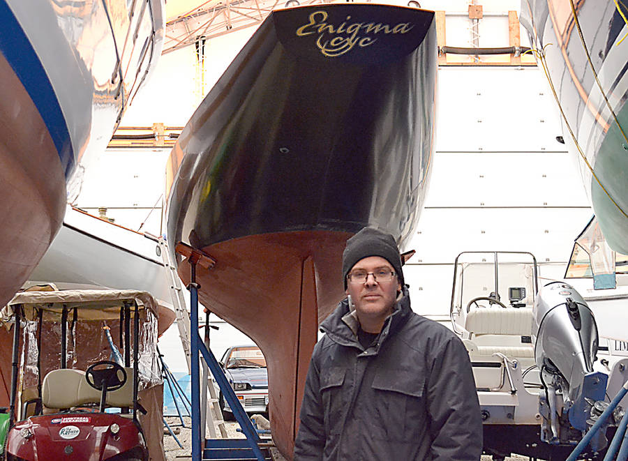 <p>GAYLE WILSON PHOTO</p><p>Tern Boatworks's owner, Bruce Thompson, in front of the International One Design boat his company was hired to build.</p>