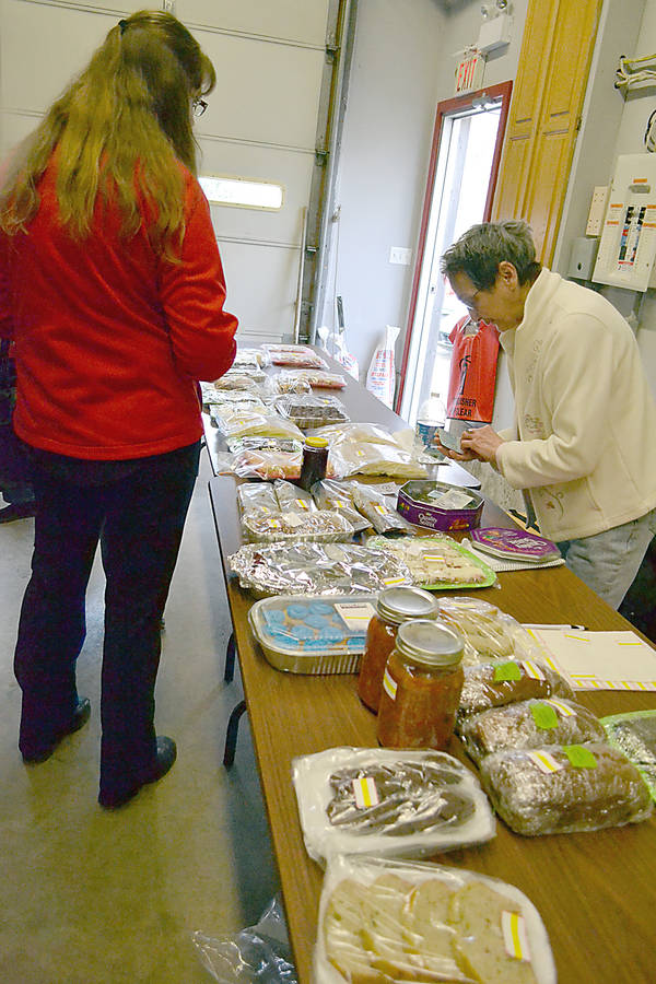 <p>GAYLE WILSON PHOTO</p><p>No shortage of baked goods at the fundraising event, which lasted from 1 p.m. to 4 p.m. April 21. Elma Deveau was one of the volunteers to help out at the tables.</p>