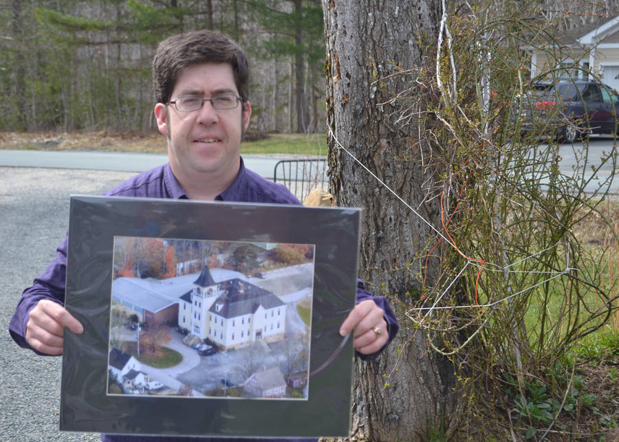 <p>FILE PHOTO</p><p>Christian Herridge and an aerial photo of his which is on display at the Mahone Bay Centre.</p>