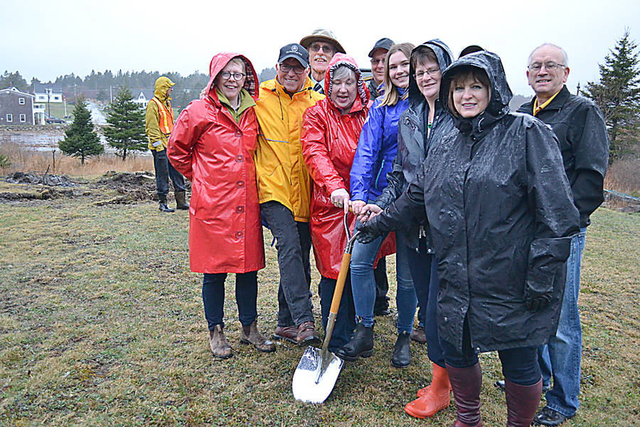 <p>GAYLE WILSON PHOTO</p><p>Student activist Stella Bowles is flanked by government officials and community members instrumental in helping to get the Straight Pipes Replacement program underway at the ground-breaking ceremony in Riverport April 30.</p>