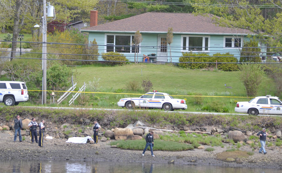 <p>KEITH CORCORAN PHOTO</p><p>RCMP examine the LaHave River riverbank in Dayspring Tuesday morning.</p>