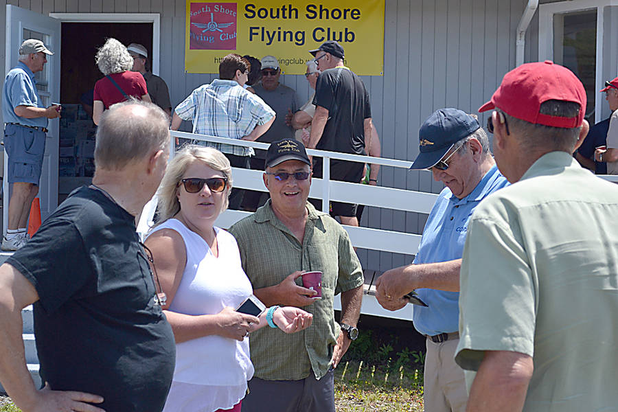 <p>GAYLE WILSON PHOTO</p><p>The MLA for Queens-Shelburne, Kim Masland, speaks with flying enthusiasts in front of the terminal building turned club house.</p>