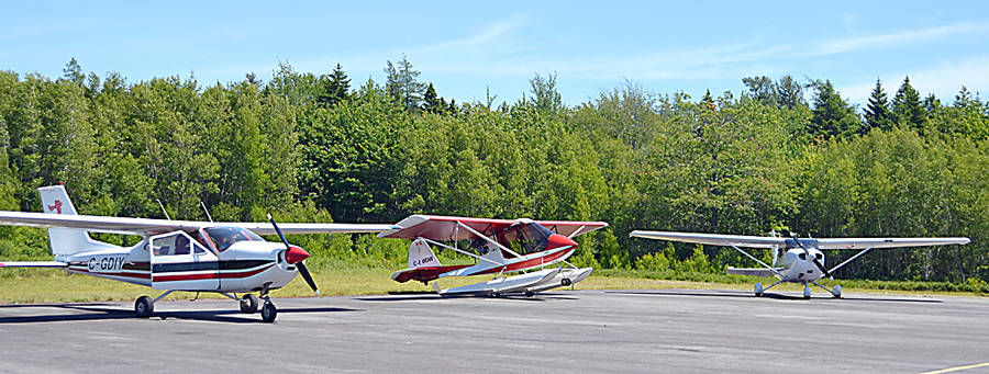 <p>Some of the aircraft that flew in for the South Shore Flying Club's open house at Liverpool airport July 8.</p><p>GAYLE WILSON PHOTO</p>