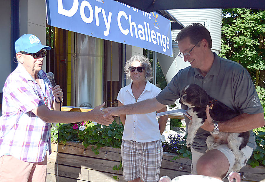 <p>GAYLE WILSON PHOTO</p><p>Danny Lohnes, president of the board of directors of the animal shelter SHAID, accepts a check for $750 from Saltbox Brewing. The money comes from a donation campaign the brew pub held through the sale of its cream ale under a special Homeward Bound Label.</p>