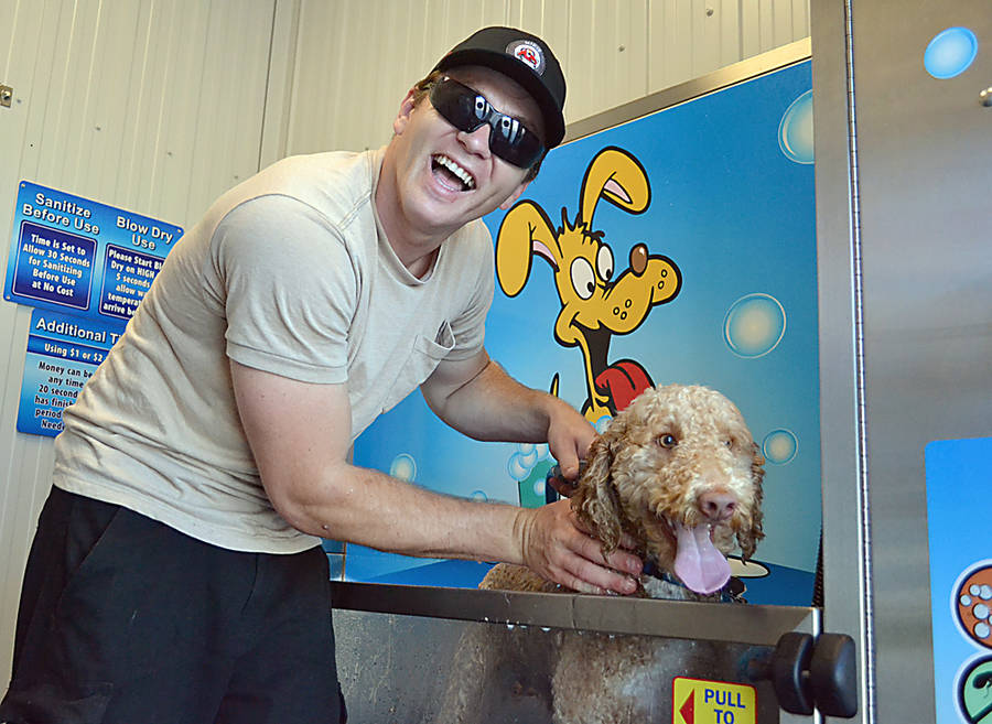"<p>GAYLE WILSON PHOTO</p><p>According to the owner of Mikiz Pitt Stop car and dog wash, ""car people and dog people go hand in hand.""</p>"