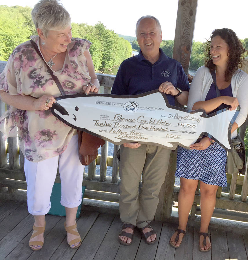 <p>KEITH CORCORAN, PHOTO</p><p>Brooke Nodding of the Bluenose Coastal Action Foundation, right, with Stephen Chase of the Atlantic Salmon Conservation Foundation and local MP Bernadette Jordan share a light moment during a ceremonial cheque presentation. The Salmon group announced August 21 in Bridgewater that the Bluenose Coastal organization was receiving a $12,500 grant toward work concerning the LaHave River watershed.</p>