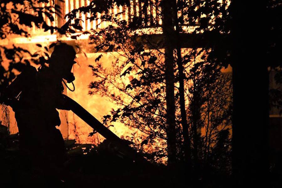 <p>André Guigue, photo</p><p>A firefighter battles an early morning blaze in Bridgewater.</p>