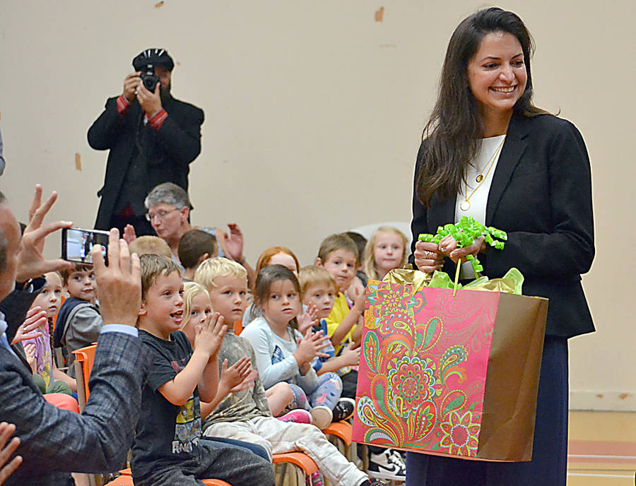 <p>GAYLE WILSON PHOTO</p><p>Stephen Sander's daughter Karen received a gift from the students at Bridgewater Elementary School.</p>