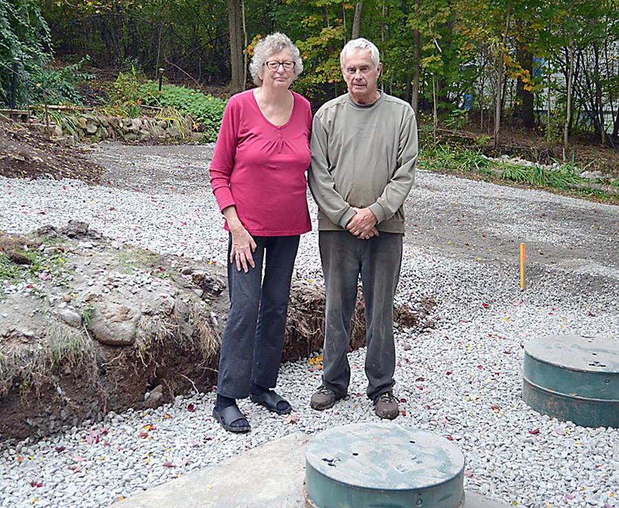 <p>GAYLE WILSON PHOTO</p><p>Denise and Michael Lee stand in front of the new septic system that was still exposed at their home in Conquerall Bank.</p>